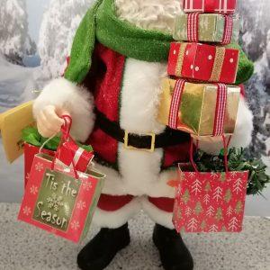 posture père noel et ses cadeaux